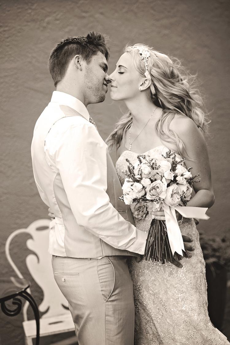 bride and groom kiss Wedding Day Photos