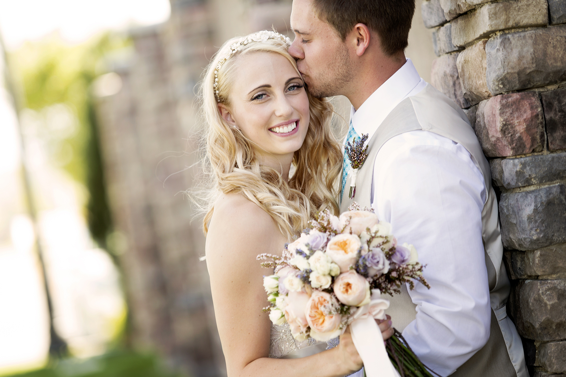 bride and groom kissing Wedding Day Photos