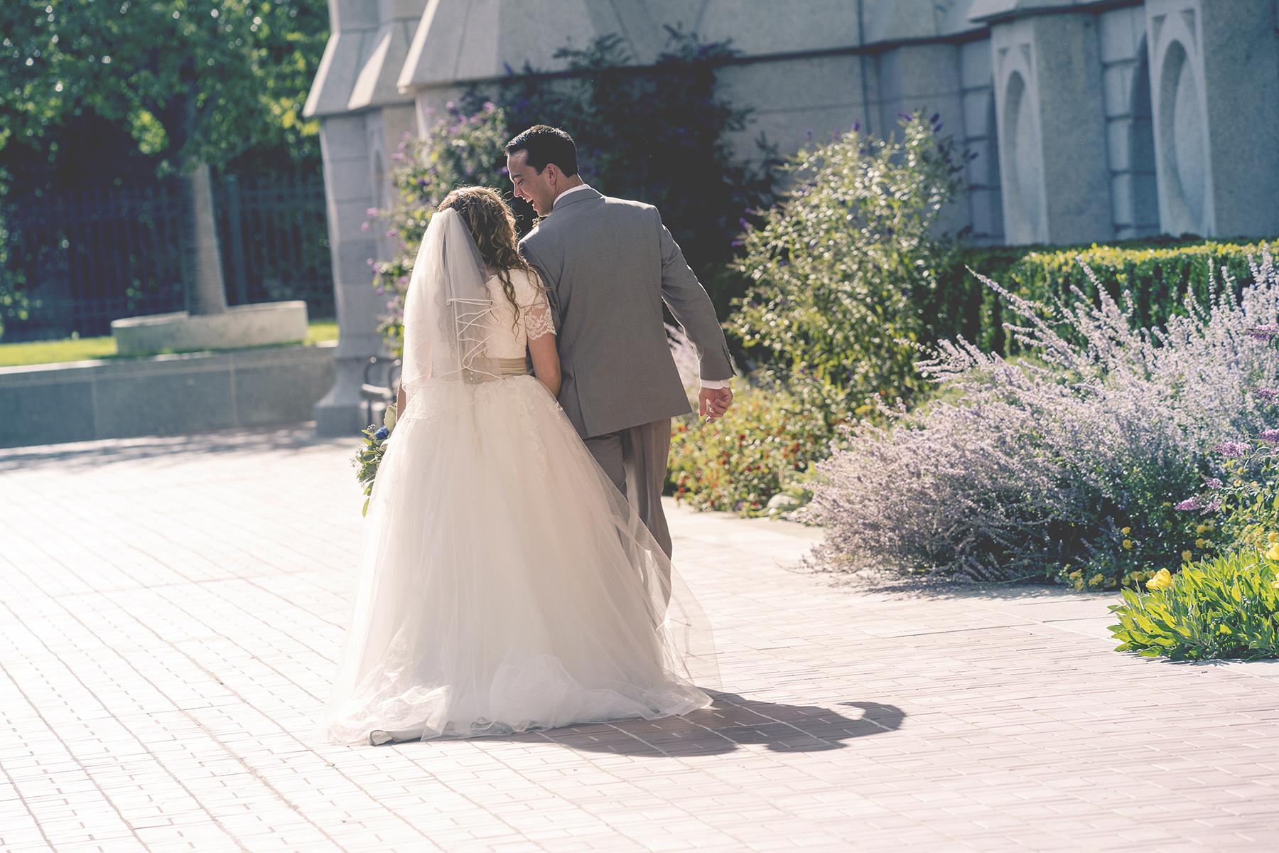 LDS Temple Weddings SLC walking away laughing