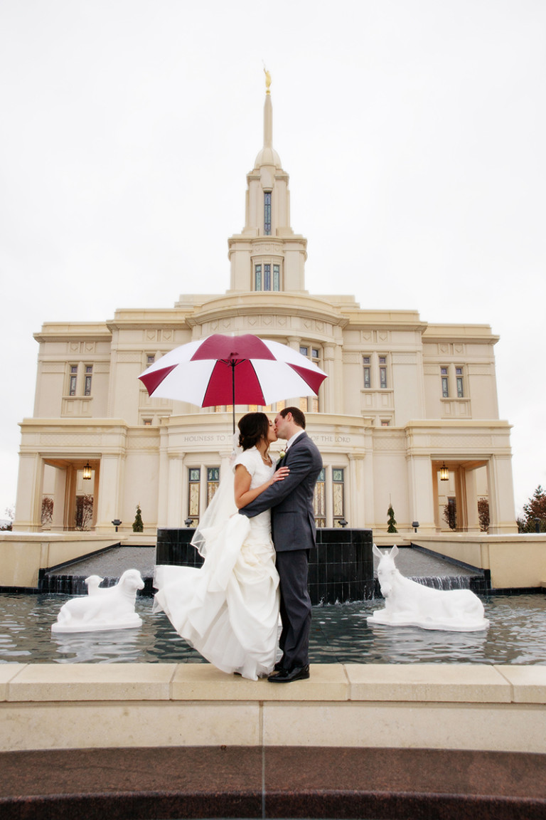 LDS Temple Weddings Payson umbrella kiss