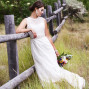 Utah Bridal Pictures leaning on fence