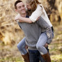 Utah Engagement Pictures piggy back hug bokeh