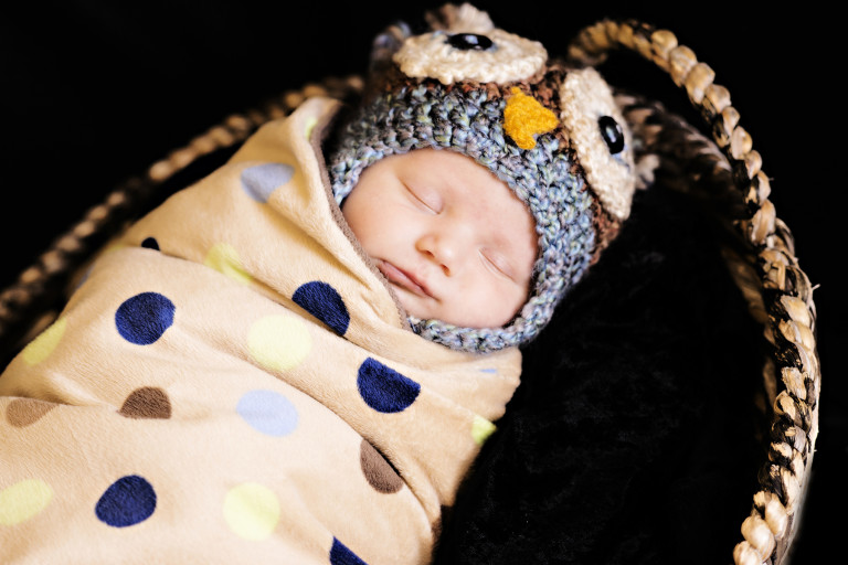 Newborn Pictures wrapped up like a burrito