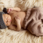 Newborn Pictures sleeping furry rug