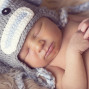 Newborn Pictures holding hands sleepiing