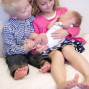 Newborn Pictures brother and sister holding baby