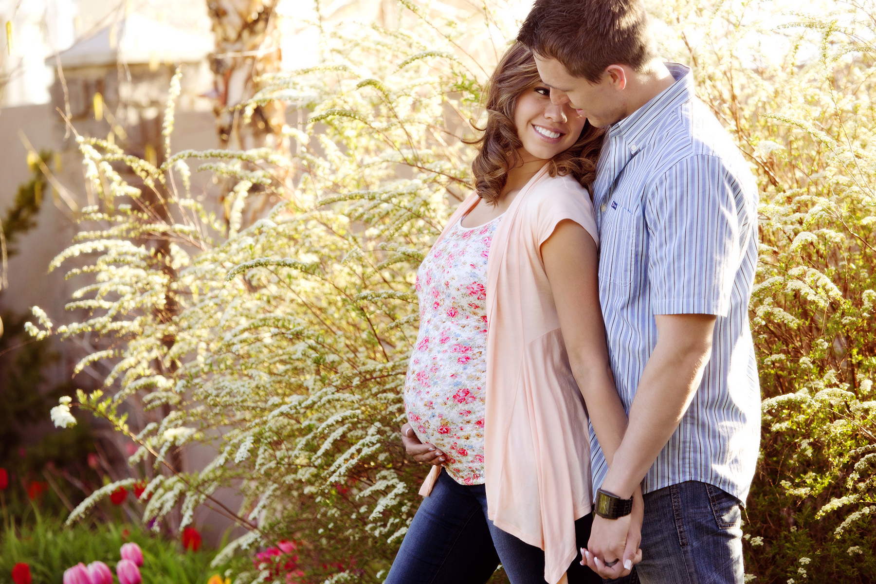 Maternity Pictures almost kiss holding hands