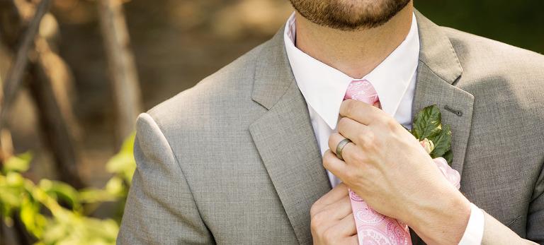 Groom fixing Pink Tie