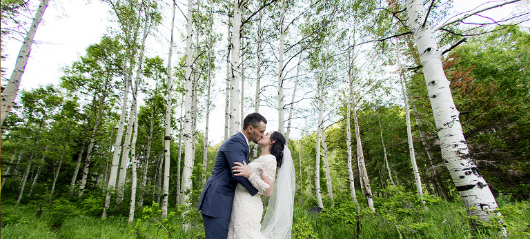 Bride and Groom in Tall Trees