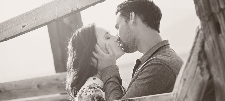 Bride and Groom Kissing during Engagement Photo Shoot