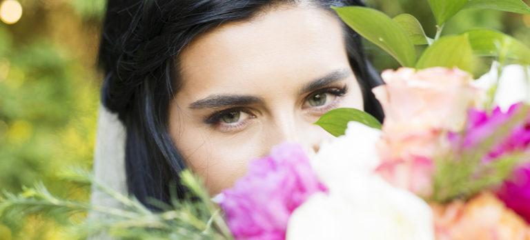 Brides Eyes peering over Flowers