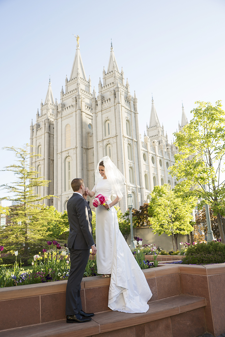 Salt Lake Temple Groom kissing brides hand