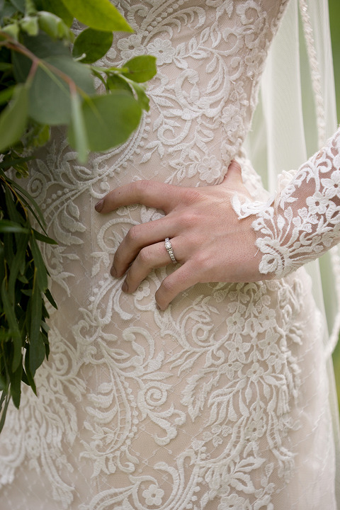 Brides Hand on Hip Lace Dress