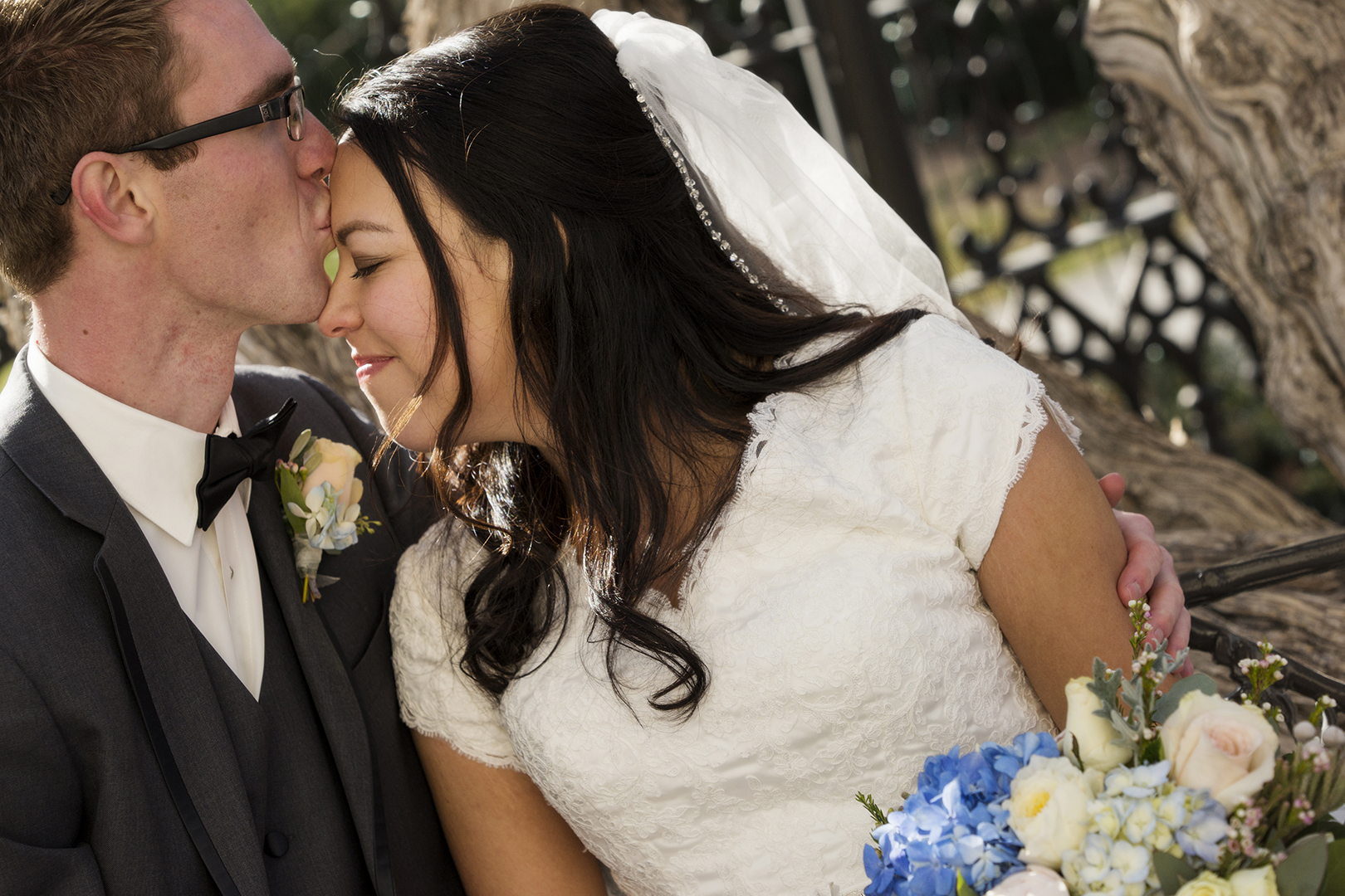 Groom Kissing Forehead of Bride