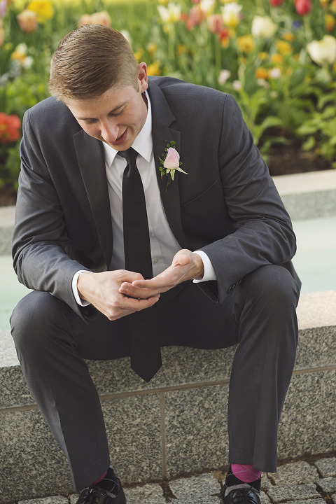 Groom looking at Ring