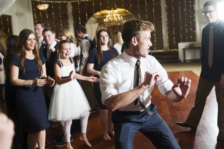 Groomsman shakes it at wedding