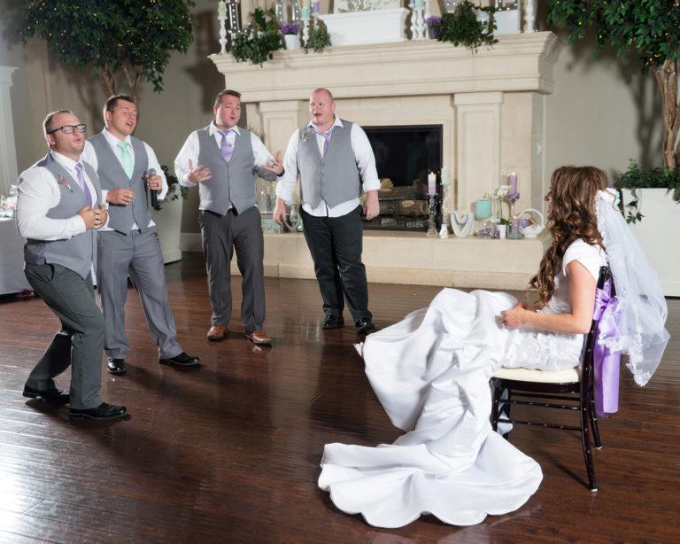 wedding groom sings to bride
