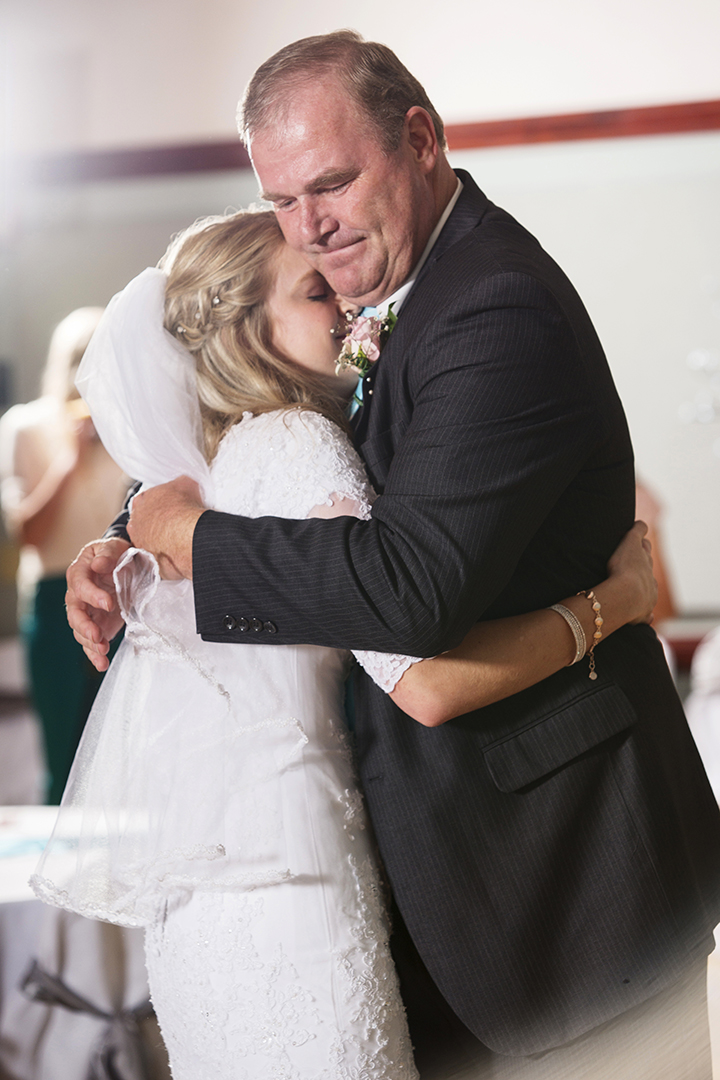 Tender embrace during daddy daughter dance