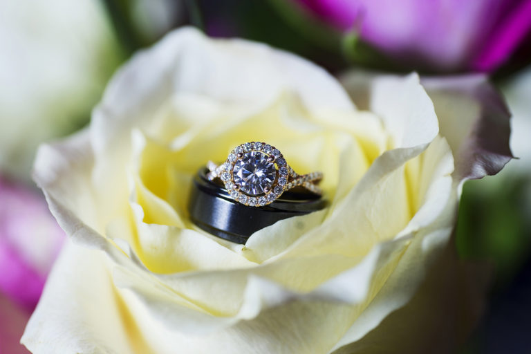 Wedding RIngs in Yellow Flowers