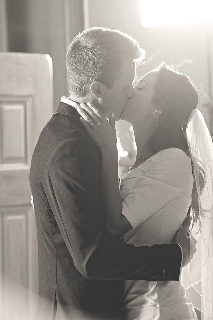 Backlit First Dance Kiss at Wedding