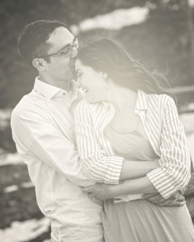 Bride and Groom laughing kissing