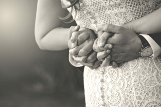 Bride and Groom Holding hands behind back