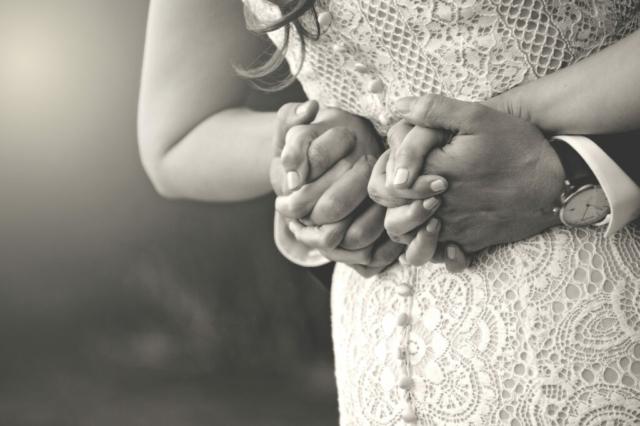 Bride and Groom Holding hands behind back